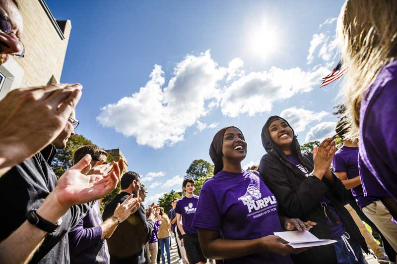 Students being welcomed to the University of St. Thomas